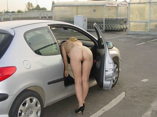 Mature wife naked in car